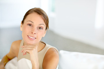 Attractive woman with hand on chin looking at camera