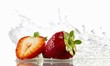 Strawberries with splashing water