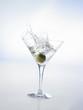 Martini with green olive (splash)