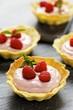 Several raspberry tarts