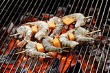 Prawn skewers on barbecue