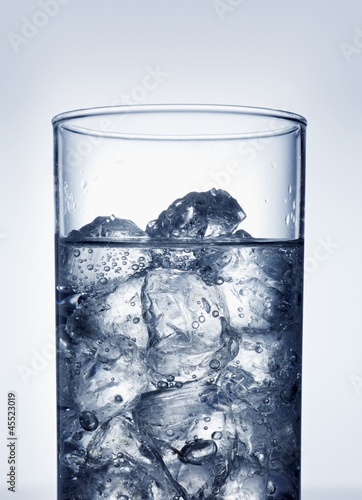 Ice cubes in glass of water