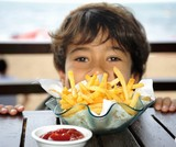 Boy at table with chips and ketchup