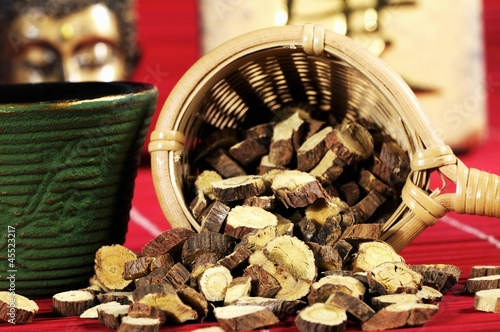 Dried Ural liquorice root in tea strainer for making tea