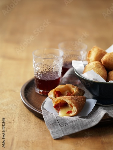 Panzerotti (deep-fried Italian dough parcels) with provolone