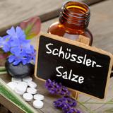 Fototapety Schüsslersalze mit Tafel und Blüten