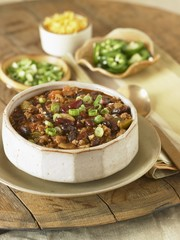 Bowl of Chili Con Carne with Assorted Toppings