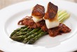Grilled Halibut and Tomato Bacon Stew On Asparagus Spears