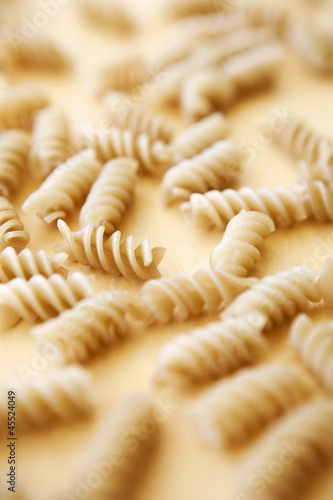 Gluten Free Spiral Rice Pasta on Wooden Surface