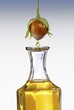 Hazel nut oil dropping from a hazel nut into a carafe