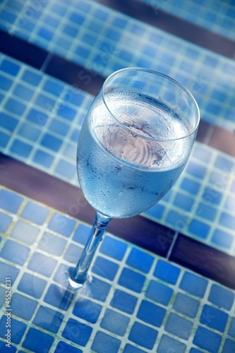 A glass of water by the pool