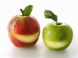 A red and a green apples with a slice taken out of each