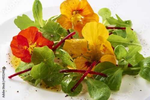 Lamb's lettuce with nasturtium flowers