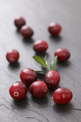 Cranberries on a slate surface