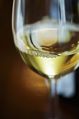 A glass of Green Veltliner wine (close-up)