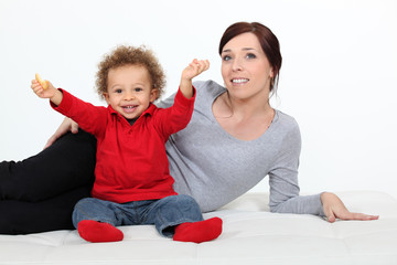 Toddler sat on the floor with mother