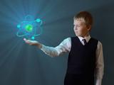 schoolboy holding glowing atom