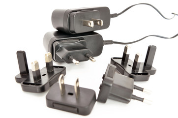 Black electrical adapters on a white background