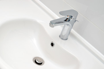 Fresh and clean washbasin and chrome tap