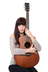 Brunette woman with guitar