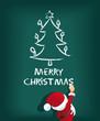 Santa Claus schreibt Merry Christmas mit Kreide
