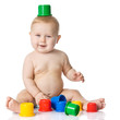 Baby playing with cup toys. Isolated on white background