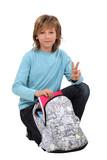 boy preparing his school bag