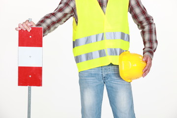 Road worker with sign