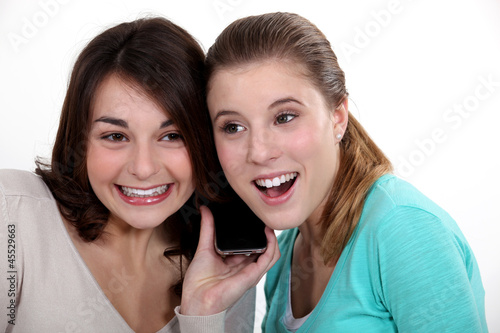 Women excitedly listening to a song
