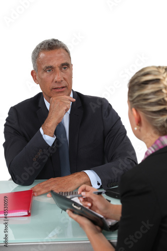 Businessman sitting with his PA