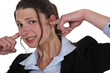 woman plugging her ears