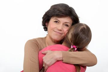Woman hugging her granddaughter