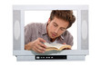Man with book behind TV frame