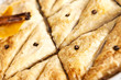 close up of delicious baklava cut into triangles.