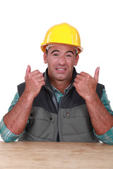 Laborer grimacing