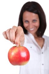 Woman stood holding red apple
