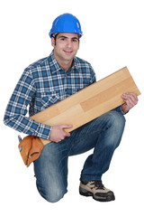 Builder with wooden flooring