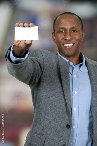 Black Man Holding Business Card