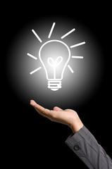 Light bulb on hand for New Idea Concept