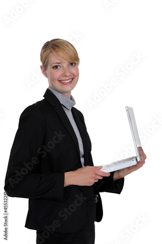 Businesswoman holding a white laptop