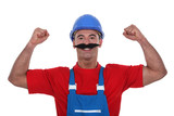 Muscular tradesman wearing a fake moustache poster