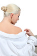 Blonde woman slipping out of a bathrobe
