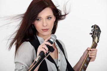 Woman with microphone and guitar