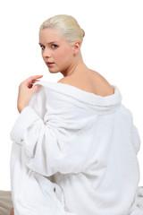 Woman taking off robe