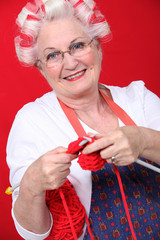 Granny with her hair in rollers and knitting