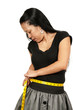 Hispanic Woman Measuring Her Waist