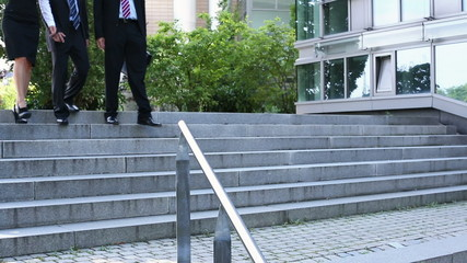 Businesspeople walking down stairs
