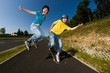Active young people - rollerblading, running