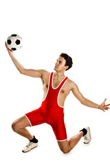 Young and handsome man with a soccer ball gymnast