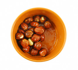 Nuts with honey in ceramic bowl